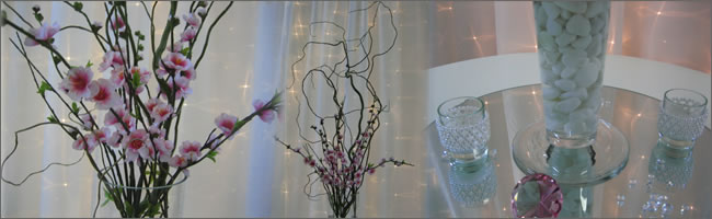 Pink blossem and twisted willow centrepiece for hire